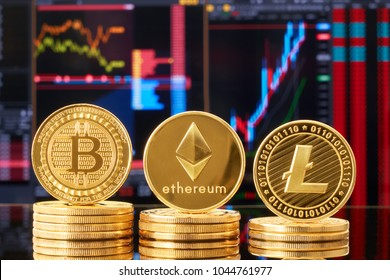 Three gold coins ripple, bitcoin, litecoin against the backdrop of a bright financial business graphics blueprint close-up. Crypto-currency. Anonymous. Virtual currency