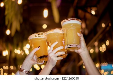 Three of Golden Beer in a Glass Stein for Oktoberfest. Pint of Draft Wheat Beers in Friendship Bachelorette Parties at Bar. Young Girls Night Life Concept.