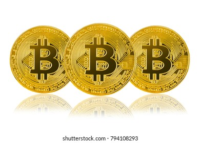 three golden bitcoin isolated on white background; cryptocurrency physical bitcoin coins