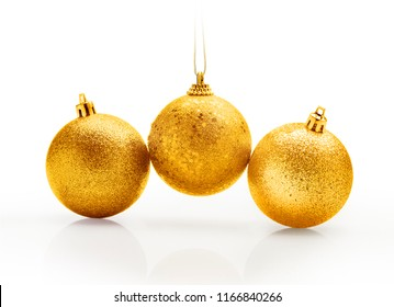 Three golden christmas sparkling balls against white background. Gradient effect on hanging tape for white copy space.