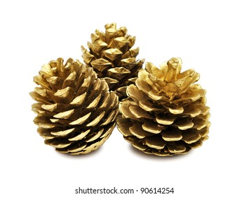 three golden pine cones isolated on the white background, with clipping path
