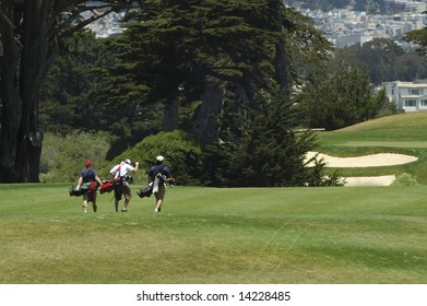 three Golfers walking the course