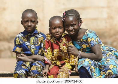 Three gorgeous African black ethnicity children posing outdoors