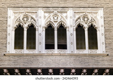 Three gothic windows in a facade of a building. Horizontal composition