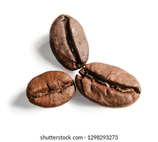 Three grains of coffee lying like flower petals. Macro. White isolated background.