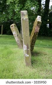Three graves stones at various angles