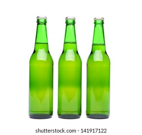 Three green beer bottle with drops drink without label on a white background