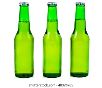 Three green beer bottles in a white background