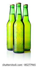 Three green bottles of beer isolated on white background
