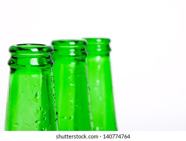 Three green bottles of chilled beer