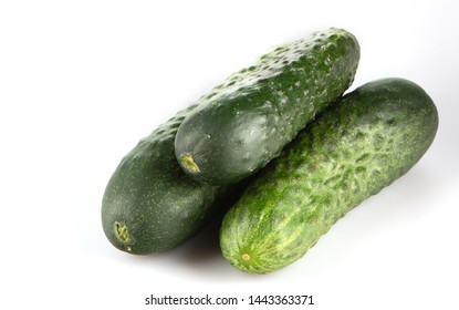 three green cucumber on a white background