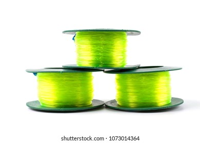 Three Green light Nylon line in green plastic roll for fishing or construction work isolated on white background