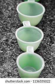 Three green measuring cups