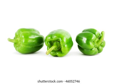 Three green pepper isolated on white