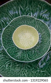 Three , green plates in the pattern of cabbage leaves.