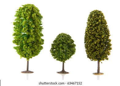 Three green trees in a row isolated over white background