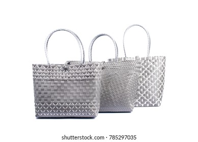 three grey wicker woman's tote bags, isolated on white background