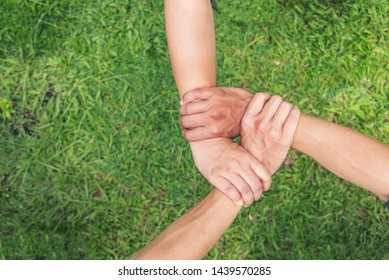 Three group volunteer hold hands together with authentic triangle partners. Three hands holding tight promise mission teamwork green ecosystem business. Customer triangle three hands trust to promise