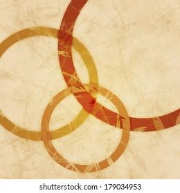 Three grungy orange circles on textured beige background