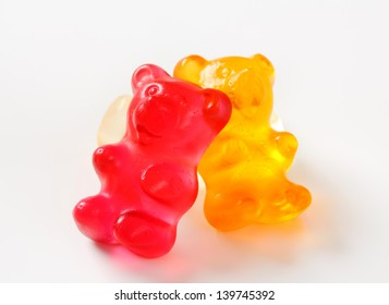 three gummy bears on a white background
