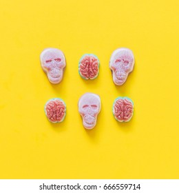 three gummy candies in the shape of Mexican skulls and three sweet brains