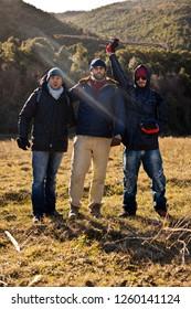 Three guys trekking in a mountain region of italy