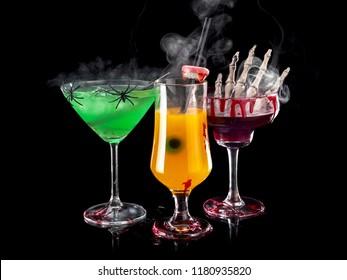 Three Halloween cocktails with smoke