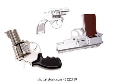 Three handguns isolated over white