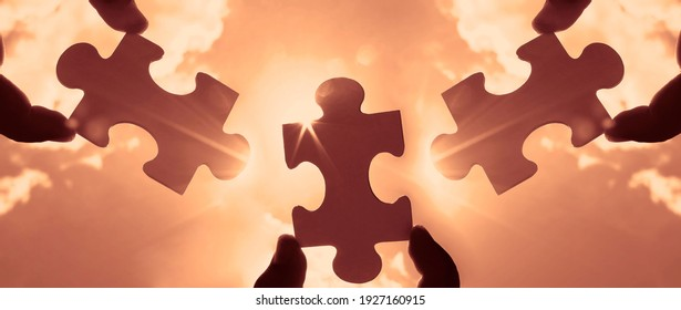 three hands of businessman to connect couple 3 piece with sky background.Jigsaw alone wooden puzzle against sun rays.one part of whole. symbol of association and connection.business strategy.