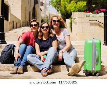 Three happy 40 years old  real women traveling together