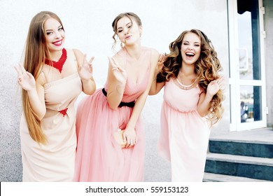 Three happy beautiful brides together. Party time of stylish women group in elegant dress celebrating birthday, having fun, wedding, prom. Friends posing for the camera