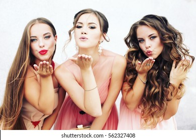 Three happy beautiful brides together. Party time of stylish women group in elegant dress celebrating birthday, having fun, wedding, prom.