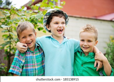 Three happy boys standing together