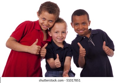 Three happy boys with thumbs up.