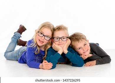 three happy children in front of white background