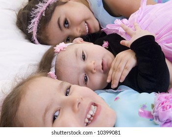 Three Happy children smiling. Bonding, Love, sisters,childhood