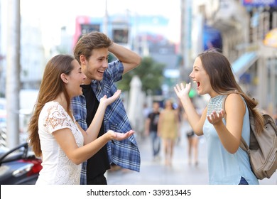 Three happy friends meeting in the sidewalk of a street of a big city with an urban background