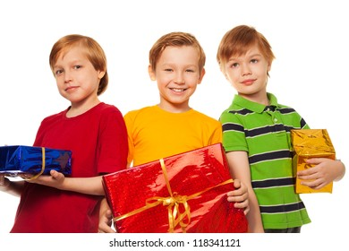 three happy friends with presents isolated on white