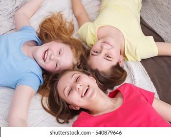 three happy girls at home