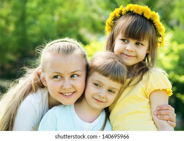 Three happy sisters with smiles looking aside
