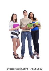 Three happy students holding books (isolated on white)