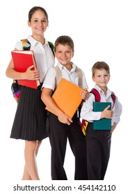 Three happy students standing with books in hands, isolated on white