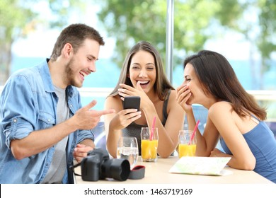 Three happy tourists laughing enjoying summer vacation in an hotel room or apartment on the beach