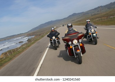 Three Harley-Davidson motorcycles cruising on Highway number 1 between Pescadero and Santa Cruz, California/ Unites States of America, February 20 - 2009