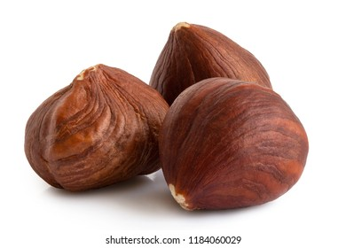 Three hazelnuts with skin isolated on white. Closeup.