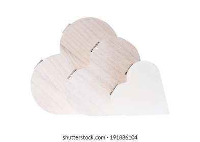 Three heart shaped wooden gift boxes isolated on white