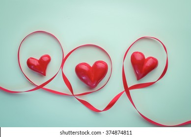 three hearts and circle of red ribbon health and valentine concept