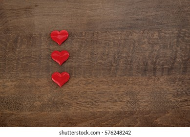Three hearts on a wood background flat lay