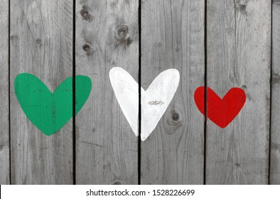 Three hearts of representing the colors of the Italian flag, green, white and red