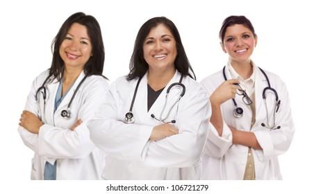 Three Hispanic Female Doctors or Nurses Isolated on a White Background.